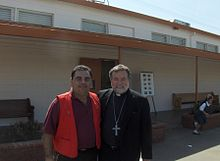 Bishop Jaime Soto with a Knight of Columbus after rededicating St. Joseph School on March 19, 2008.JPG