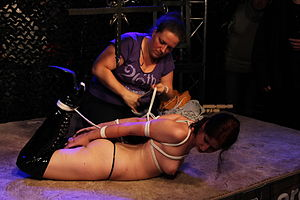 Hogtie bondage - A hogtie bondage being showcased at an adult event in Germany
