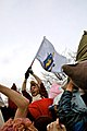 Boston Pillow Fight 2009, man with flag.jpg