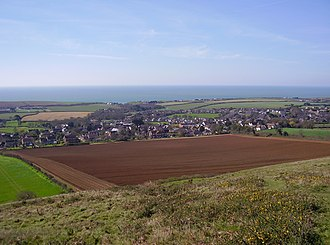 Brighstone - View of Brighstone from Limerstone Down, looking south-west, with the English Channel in the distance