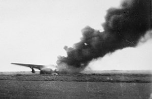 A USAAF B-24 Liberator on fire at Broome Airfield following the attack.