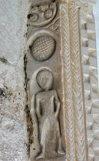 All Saints Church, Buncton - The mysterious carving on the chancel arch, pictured shortly before its destruction in 2004
