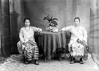 Peranakan - Two Peranakan women at a tin factory in Pulau Singkep, Riau Islands.
