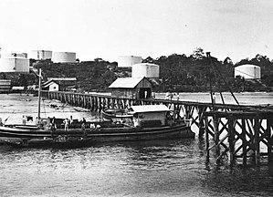 Tarakan Island - Oil storage tanks and a pier at Tarakan photographed between 1905 and 1914