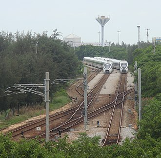 Hainan western ring high-speed railway - China Railways CRH1A-A trains on the short lines between the Haikou Railway Station and South Port, Haikou, in June 2017