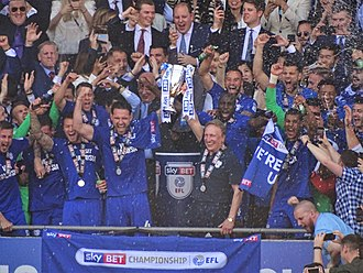 Manager Neil Warnock and players lift the 2017-18 EFL Championship runner-up trophy Cardiff City celebrations 2018.jpg