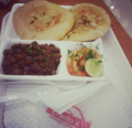 Chhole Kulche served with baked chick peas.PNG