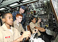 Chief Electronics Technician (SS) Terry Butts explains basic submarine command and control operations to a group of Radford High School Navy Junior Reserve Officer Training Corps cadets.jpg