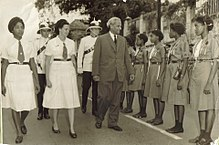 Chief Minister Norman Manley walks in a parade.jpg