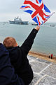 Child Waving Flag as HMS Ark Royal Leaves Portsmouth for the Final Time MOD 45155470.jpg