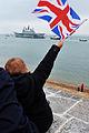 Child Waving Flag as HMS Ark Royal Leaves Portsmouth for the Final Time MOD 45155470.jpg