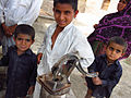 Children at a water pump, Sindh, Pakistan, April 2012 (8405077511).jpg