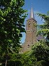 foto van R.K. Kerk (oorspronkelijk een Salvatorkerk) bestaande uit een ten dele ingebouwde westtoren