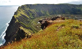 Orongo - The 300-meter sheer cliff face of Rano Kau down which egg-hunters would climb to reach the ocean during the annual egg hunt.  Orongo is on the very top of the crater's rim on the left.