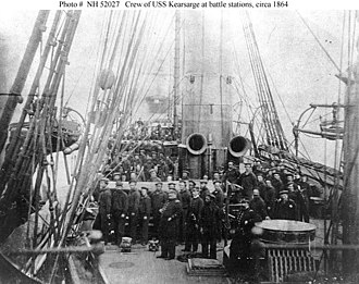 USS Kearsarge (1861) - Crew of the USS Kearsarge in 1864 after the battle; showing both 11 Inch guns pointed to starboard as they were during the battle.