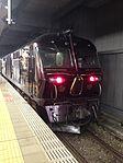 "Cruise train ""Seven Stars in Kyushu"" stopping at Hakata Station 2.jpg"