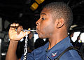 Defense.gov News Photo 100904-N-5969B-006 - U.S. Navy Boatswain s Mate 3rd Class Aaron Shorts pipes the mess call into the main public address circuit aboard the amphibious assault ship USS.jpg
