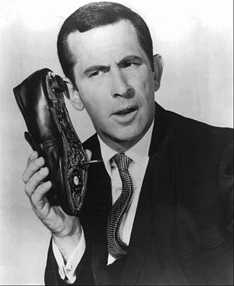 Get Smart - Don Adams, as Maxwell Smart, holding the famous shoe phone