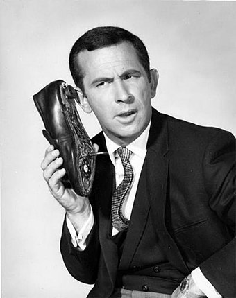 Don Adams, as Maxwell Smart, holding the famous shoe phone DonAdams.jpg