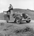Dorothea Lange atop automobile in California (restored).png