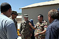 Egyptian army Capt. H.A. Rauof, center right, speaks with U.S. Soldiers assigned to the Regional Communications Center, Combined Joint Task Force (CJTF), 101st Airborne Division during their visit to the El 130827-A-YW808-026.jpg