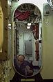 Electronics Technician 3rd Class Jason Blank works on a knee knocker on the 02 level of the ship 020410-N-HX866-001.jpg