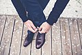 Elegant man tying shoes (Unsplash).jpg
