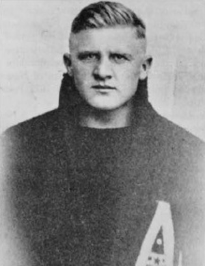 Elmer Oliphant - Oliphant in Army letterman's jacket.