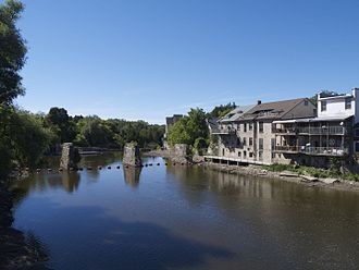 Elora, Ontario - Restored buildings on Water St., (shops and restaurants), line the Grand River in the downtown area.
