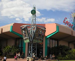 Innoventions (Epcot) - An entrance to the Innoventions pavilion, as it appeared in February 2005. Since this photo was taken, the sign tower in front of the building has been removed, as well as the Mickey wand on Spaceship Earth in the upper right.
