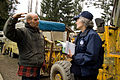 FEMA - 39904 - FEMA Community Relations workers speak with a resident in Washington.jpg