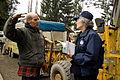 FEMA - 39904 - FEMA Community Relations workers speak with a resident in Washington.jpg