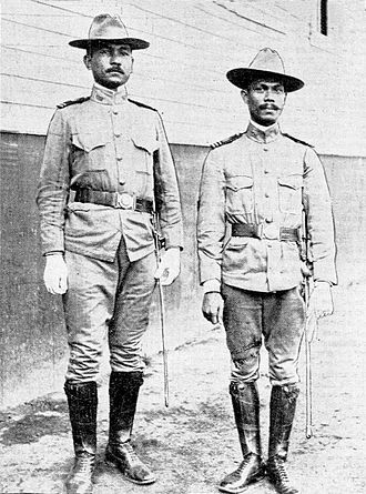 Philippine Constabulary - Two Constables posing for a photo in the New York Tribune' in 1905.