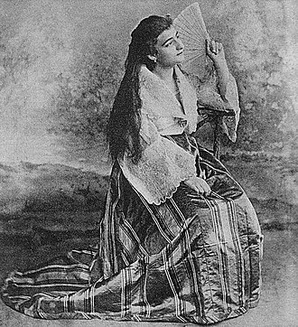 Filipino mestizo - Spanish-Filipina Mestiza wearing the traditional Maria Clara gown of the Philippines and the long hair tradition of the FIlipina women during the colonial era