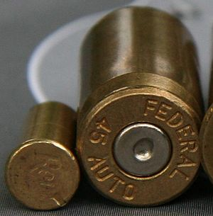 Rimfire ammunition - Fired rimfire (left) and centerfire cartridges. A rimfire firing pin produces a notch at the edge of the case; a centerfire pin produces a divot in the center of the primer.