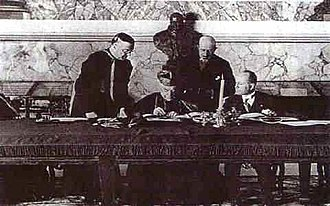 Clerical fascism - Mussolini (far right) signing the Lateran Treaty (Vatican City, 11 February 1929)