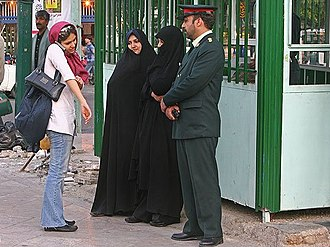 Human rights in the Islamic Republic of Iran - Three polices warned a woman to cover her sleeves.