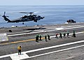 Flickr - Official U.S. Navy Imagery - A helicopter approaches the flight deck of USS George H.W. Bush..jpg