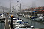 Fog in harbour (2089601984).jpg