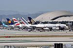 Four Airbus A380 at Los Angeles International Airport.jpg