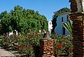 Garden and Pepper Tree, Mission San Luis Rey, CA 9-16 (30824095672) (cropped).jpg