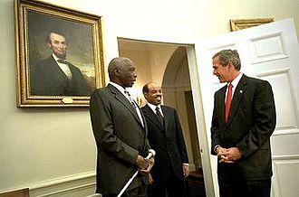Meles Zenawi - President George W. Bush welcomes President Daniel arap Moi of Kenya and Meles Zenawi to the Oval Office, December 2002