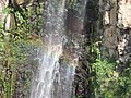 Gilbon River waterfall rainbow close-up.jpg