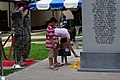 Gold Star Families, and U.S. Soldiers assigned to the 82nd Airborne Division, pay their respects to fallen Soldiers, during the Division's annual All American Week memorial ceremony, at the 82nd Airborne Museum 130523-A-PO583-143.jpg