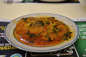 Tomato sauce - Chile relleno covered in tomato sauce served at a traditional fonda restaurant.