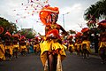Guadeloupe winter carnival, Pointe-à-Pitre parade. A young woman, performer wearing traditional carnival outfit (waist up outdoor portrait)-3.jpg