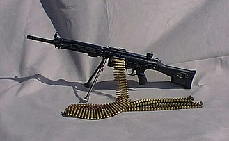Heckler & Koch HK21 - HK21 with ammunition belts and bipod positioned at the rear near its point of balance