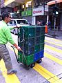 HK Yau Ma Tei Nathan Road AS Watsons distilled water bottle Logistics 12 plastic containers morning Feb-2014 hand cart.JPG