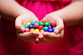 Handful of colourful candies (10422047853).jpg