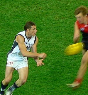 Handball (Australian rules football) - Former AFL player Heath Scotland executes a rocket handpass to a teammate while under pressure.